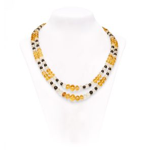 A 2-row necklace of graduated faceted citrine and rock crystal beads with round black onyx beads strung to a 14ct yellow gold bar clasp.